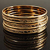 Gold Tone Smooth & Textured Metal Bangles - Set of 7 Pcs