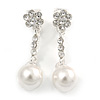 White Faux Glass Pearl Crystal Floral Drop Clip On Earrings In Rhodium Plated Alloy - 35mm L