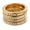 Set of 4 Message 'Live, Dance, Love, Sing' Stack Rings In Gold Tone - Size 7